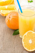 orange juice and slices fruit on wood