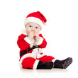 cute kid in Santa Claus clothes