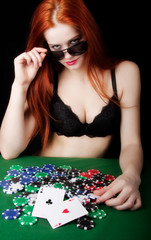 Sexy girl playing poker