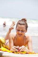 beautiful girl sunbathes on a tropical beach