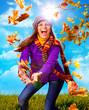 mädchen wirft Blätter im Herbst / active autumn 07