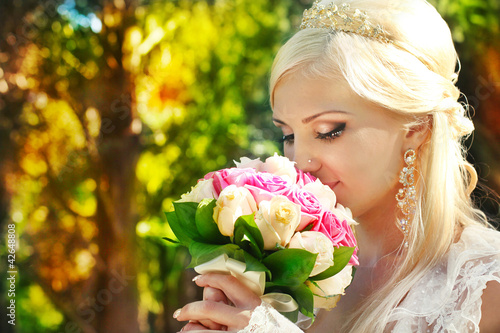 Bride with bouquet in the hands