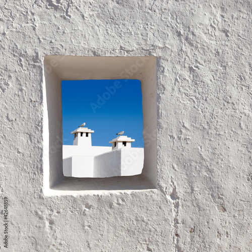 Balearic islands white chimney through window