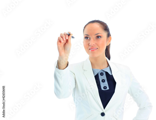 A pensive businesswoman writing with a marker, isolated on white