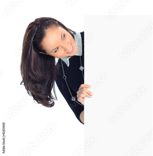 Smiling beautiful young business woman showing blank signboard