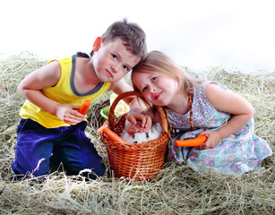 the girl with the boy on hay iron a favourite rabbit
