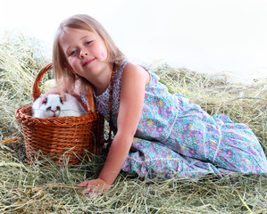 the girl on hay iron a favourite rabbit sitting in a basket