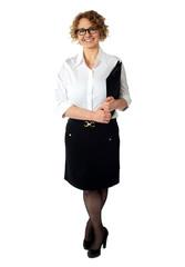 Female executive holding clipboard. Isolated