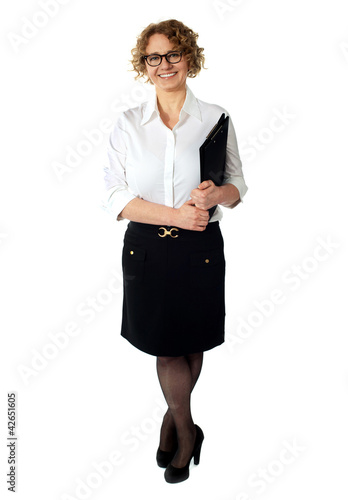 Female executive holding clipboard. Isolated