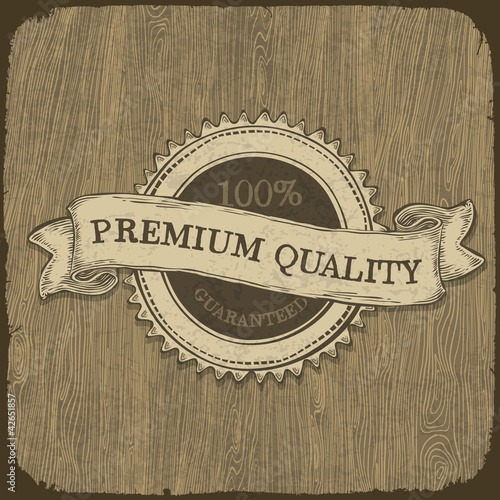 Vintage label with premium quality text on wooden texture.  Vect