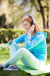 Woman listening to music outdoors