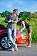 Man is waiting his girlfriend repairs a broken car
