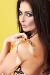 Seductive woman with feathers