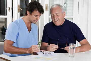 Mature Man playing Sudoku Puzzle