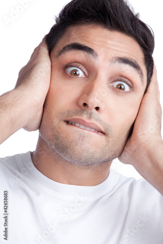Young Asian Man Covering Ears