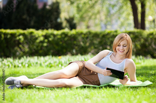 Woman using digital tablet outdoors