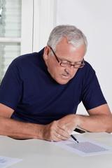 Mature Man playing Scrabble Game