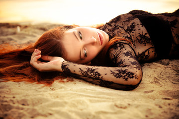 redhead woman on sand