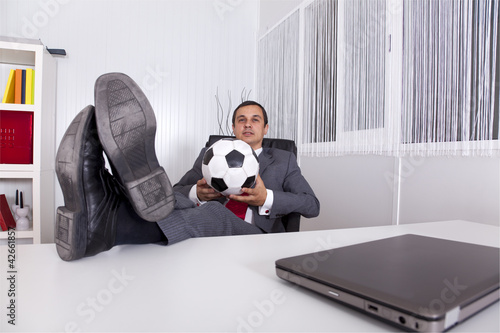 Soccer manager at the office