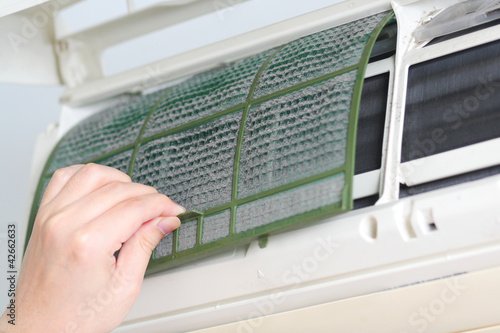 Removing dirty air-conditioner filter for cleaning