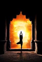 Yoga silhouette in temple