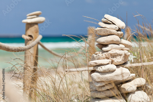 Balanced stones near the beach. Formentera island. Spain.
