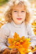 Funny kid in autumn