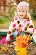 Child on playground in autumn