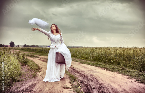 The offended bride throwing out a wedding veil