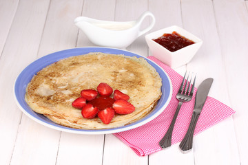Stack of tasty pancakes on wooden background