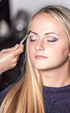 Eyebrow shaping in professional studio. poster