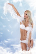 woman in white lingerie as angel on the clouds