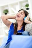 Teenage girl dancing happy fun to music on phone