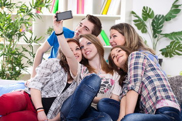 Teenagers taking group photo