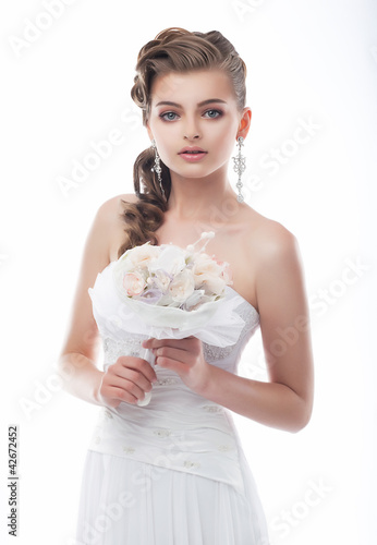 Happy beautiful bride with bouquet of wedding flowers