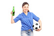 A happy female fan holding a beer bottle and football