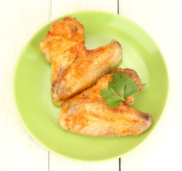 roasted chicken wings with parsley in the plate