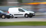 Blur white van,  panning, blur and move poster