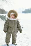 Happy smiling boy in winter clothes