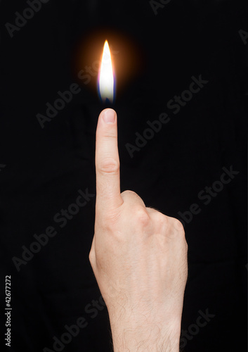The hand with the flame at the end of the finger