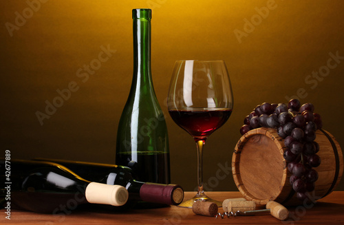 Fototapety, obrazy : In wine cellar. Composition of wine bottles and runlet