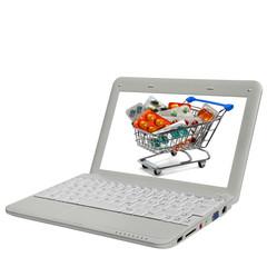 Notebook mit Medikamenten in Einkaufswagen