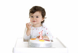 Baby enjoying his birthday cake
