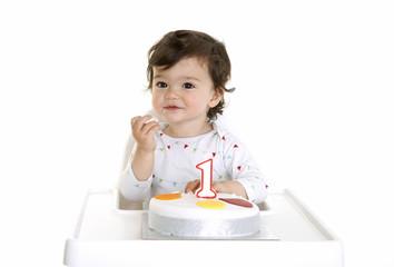 Baby enjoying his birthday cake