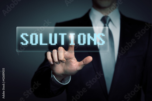 businessman pressing virtual solutions button