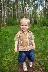 Happy little boy in forest