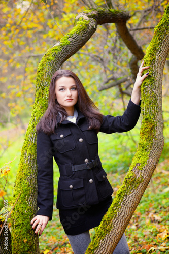 Beautiful young women in the autumn park
