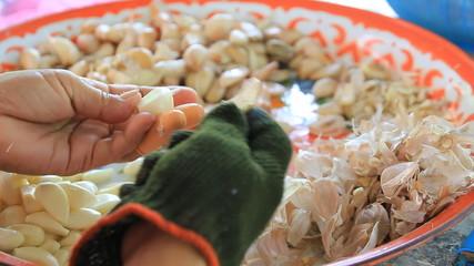 Peel the garlic a lot.