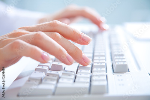 hands on computer keyboard
