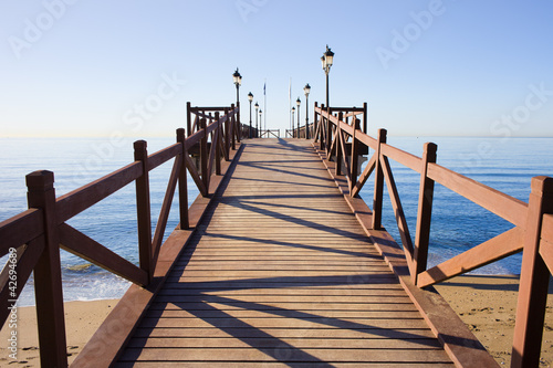 Leinwanddruck Bild Pier on Costa del Sol in Marbella